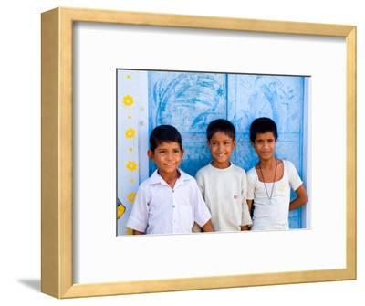 Children Against Blue Wall in Jaipur, Rajasthan, India
