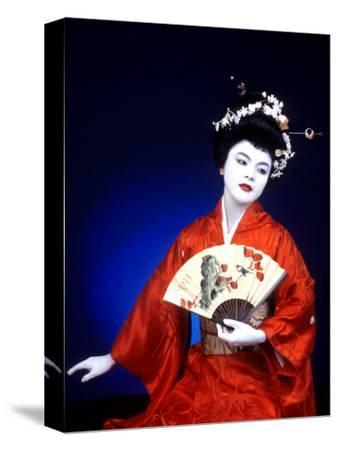 Close-up of Geisha Girl in Blue with Fan, Kyoto, Japan