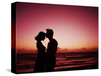 Couple Enjoying a Romantic Sunset on the Beach