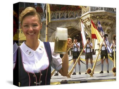German Woman Holding Stein of Beer, Oktoberfest