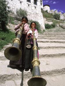 Girls Playing Horns, Potala Palace, Lhasa, Tibet by Bill Bachmann