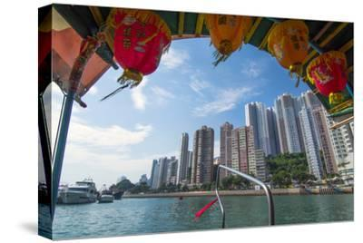 Hong Kong, China. Aberdeen from Boat in Water of Reclaimed Land with Skyscraper Condos