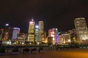 Hong Kong, China. Night Skyline with Twilight in City at Harbor by Bill Bachmann