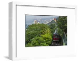 Hong Kong, China. Victoria Peak Tram Going Down Mountain on Smoggy, Hazy, Foggy Day by Bill Bachmann