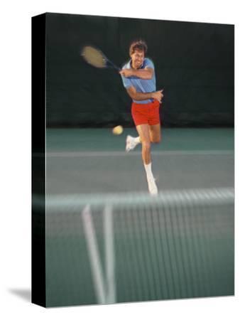 Man Hitting Tennis Ball