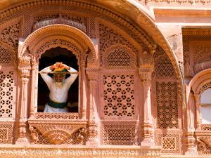 Man in Window of Fort Palace, Jodhpur at Fort Mehrangarh, Rajasthan, India by Bill Bachmann