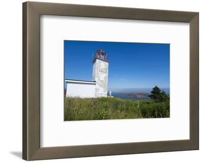 Martins, New Brunswick, White Old Traditional Historic Lighthouse Ion Water with Fields on Cliff