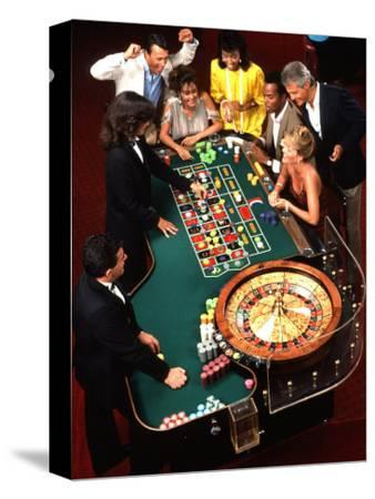 Mixed Ethnic Couples Enjoying Themselves in a Casino