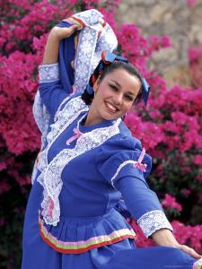Native Dancer in Colored Dress with Flowers, Mexico by Bill Bachmann