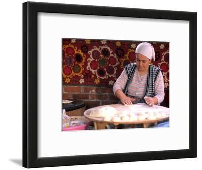 Native Woman Baking Bread in Istanbul, Turkey