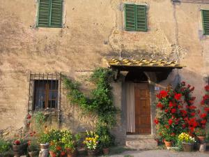 Old Home with Flowers at San Gimignano, Tuscany, Italy by Bill Bachmann