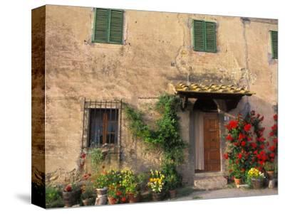 Old Home with Flowers at San Gimignano, Tuscany, Italy
