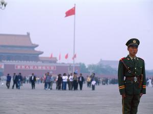 Policeman, Tiananmen Square, Beijing, China by Bill Bachmann