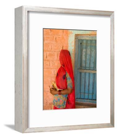 Portrait of Woman in Red Sari Against School Wall, Jodhpur, Rajasthan, India