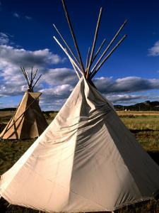 Sioux Teepee at Sunset, Prairie near Mount Rushmore, South Dakota, USA by Bill Bachmann