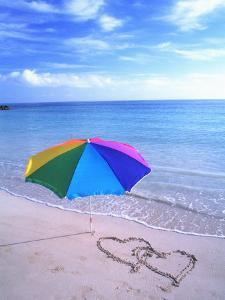 Umbrella on the Beach with Hearts Drawn in the Sand by Bill Bachmann