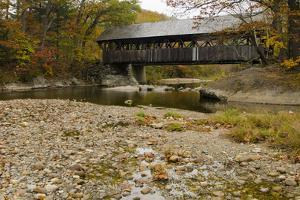USA, Maine, Bethel. Newry Covered Bridge over River in Autumn by Bill Bachmann
