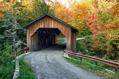 USA, Vermont, Montgomery. Creamery Bridge with Fall Foliage