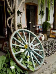 Wagon Wheel, La Posada De Don Rodrigo Hotel, Antigua, Guatemala by Bill Bachmann