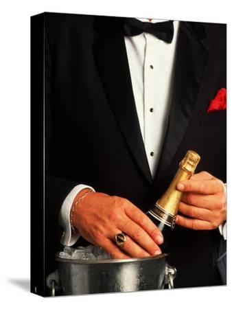 Waiter in Tuxedo with Bottle of Chilled Champagne