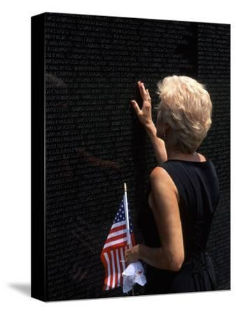 Woman at Vietnam Memorial, Washington D.C., USA