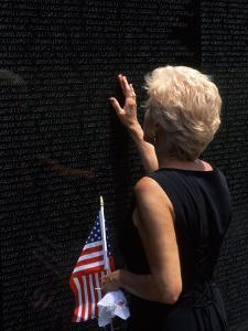 Woman at Vietnam Memorial, Washington D.C., USA by Bill Bachmann