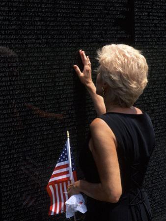Woman at Vietnam Memorial, Washington D.C., USA
