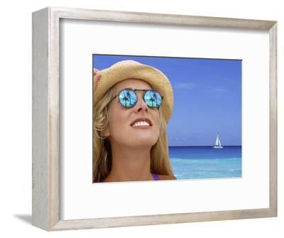 Woman in Caribbean with Palm Trees Reflected in Sunglasses