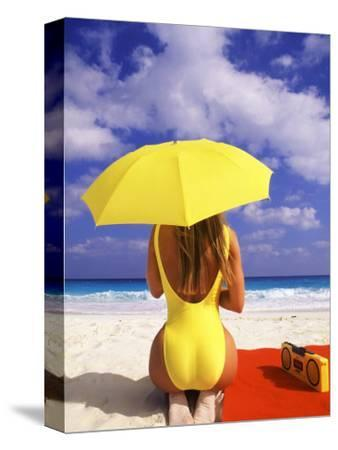 Woman in Yellow Swimsuit with Umbrella