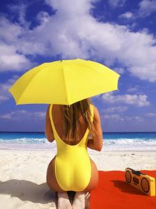 Woman in Yellow Swimsuit with Umbrella by Bill Bachmann