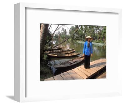 Woman Near Old Boats, Mekong Delta, Vietnam
