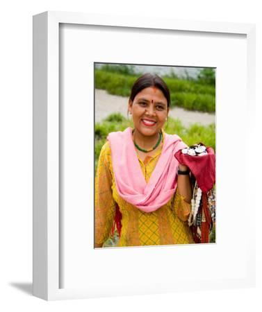 Woman with Sari Dress Selling Items at Laxmi Narayan Temple, New Delhi, India