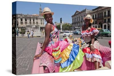 Women with Flowers at Capital in Pink Ford, Havana, Cuba
