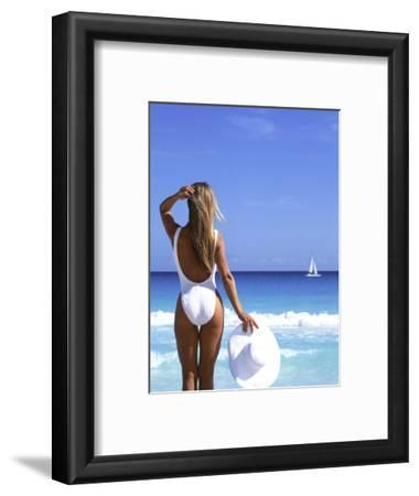 Young Woman in Swimsuit with White Hat