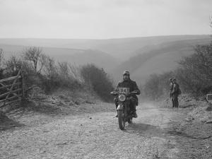 498 cc Triumph of CJ Dennis, MCC Lands End Trial, top of Beggars Roost, Exmoor, 1939 by Bill Brunell
