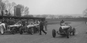 Alfa Romeo and two Bugatti Type 35s on the start line, Donington Park, Leicestershire, 1935 by Bill Brunell