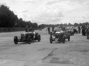 Aston Martins, Salmson and MG at the start of the LCC Relay GP, Brooklands, 25 July 1931 by Bill Brunell