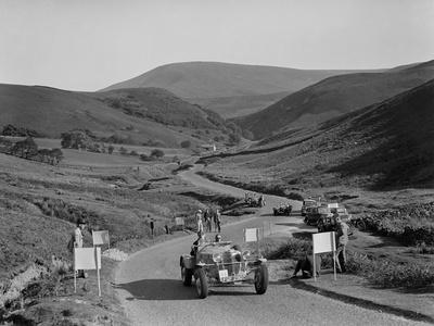 K Hutchisons winning Allard Special leading R Fieldings Jaguar SS at the Blackpool Rally, 1939