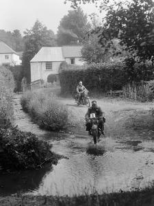 Motorcycles competing in the B&HMC Brighton-Beer Trial, Windout Lane, near Dunsford, Devon, 1934 by Bill Brunell