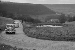 Rover of BN Wilmott and Jaguar SS of Dr AR Gray competing in the RAC Rally, 1939 by Bill Brunell