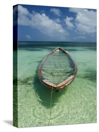 A Boat Submerged in Crystal Clear Water