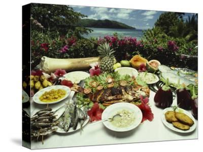 A Table Spread with Fruit and Seafood Prepared in the Local Creole Way
