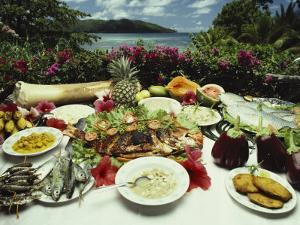 A Table Spread with Fruit and Seafood Prepared in the Local Creole Way by Bill Curtsinger
