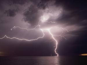 Dramatic Lightning Flashes Over Water by Bill Curtsinger