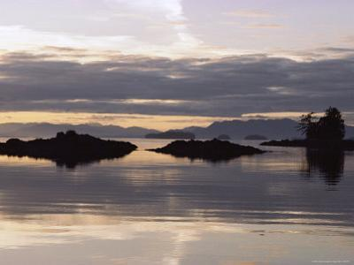 Islands and Clouds Reflect on a Calm Sea at Kah Shakes Cove