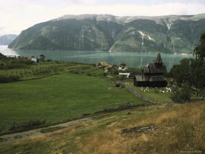 Scenic Mountain and Fjord View with Urnes Stave Church in Foreground