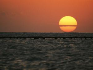 Sunset on the Water at Key West by Bill Curtsinger