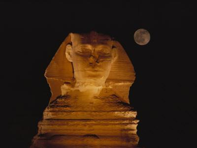 A View of the Great Sphinx at Night, Lit by a Light Show and Backed by a Full Moon by Bill Ellzey