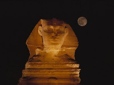 A View of the Great Sphinx at Night, Lit by a Light Show and Backed by a Full Moon