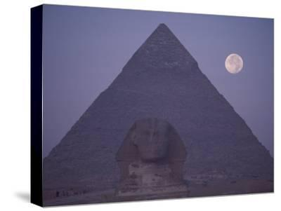 A View of the Great Sphinx with a Full Moon and the Great Pyramid in the Background